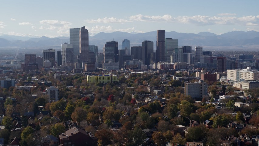 5.7K stock footage aerial video of the city's skyline with Rockies in the background, Downtown Denver, Colorado Aerial Stock Footage | DX0001_001749