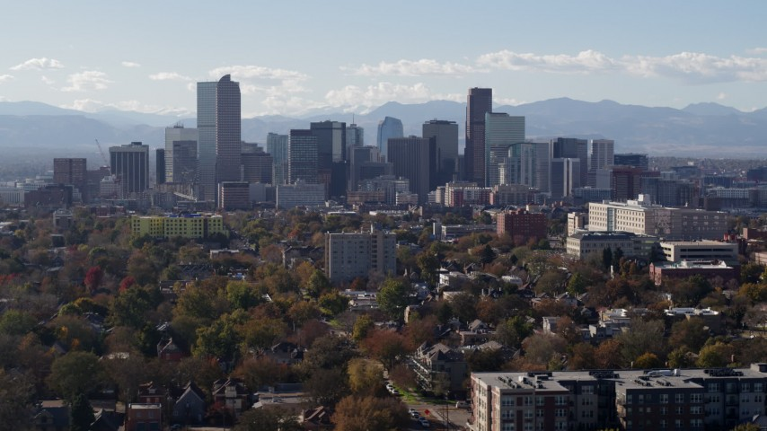 5.7K stock footage aerial video of the city's skyline with Rockies in the background, reveal clock tower, Downtown Denver, Colorado Aerial Stock Footage | DX0001_001750