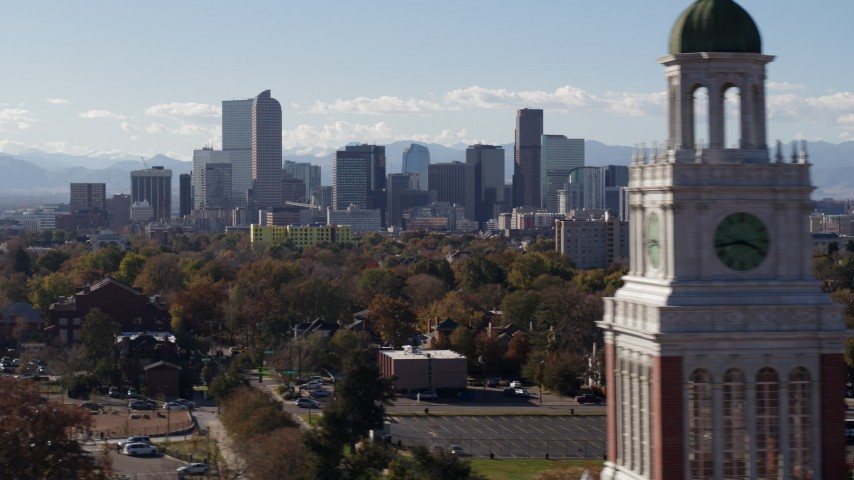 5.7K stock footage aerial video of the city's skyline with Rockies in the background, pause for stationary view, Downtown Denver, Colorado Aerial Stock Footage | DX0001_001751