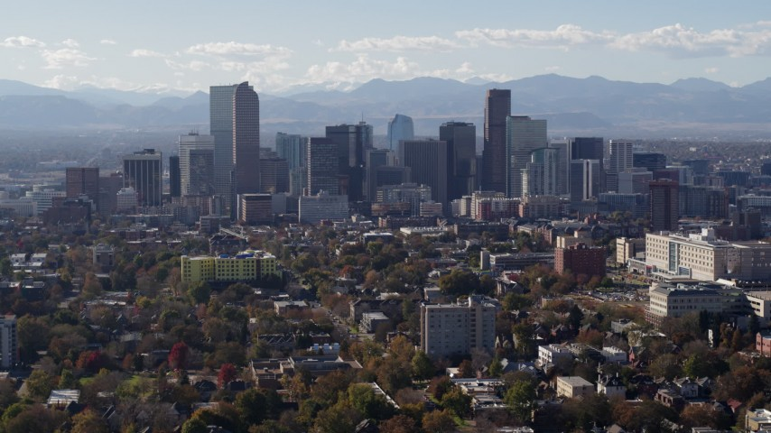 5.7K stock footage aerial video of flying by the city's skyline with Rockies in the background, Downtown Denver, Colorado Aerial Stock Footage | DX0001_001753