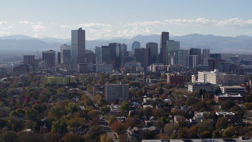 5.7K stock footage aerial video of flying by the city's skyline with Rockies in the background, Downtown Denver, Colorado Aerial Stock Footage | DX0001_001754