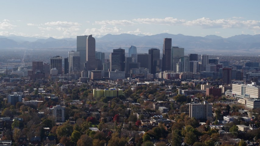 5.7K stock footage aerial video of flying by the city's skyline with Rockies in the background during ascent, Downtown Denver, Colorado Aerial Stock Footage | DX0001_001755