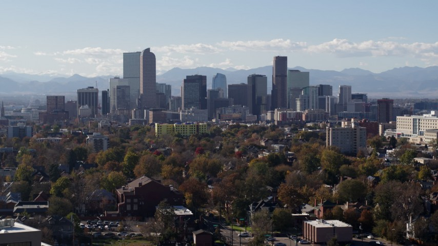 5.7K stock footage aerial video of the city's skyline with Rockies in the background during descent, Downtown Denver, Colorado Aerial Stock Footage | DX0001_001756