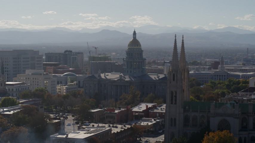 5.7K stock footage aerial video of the Colorado State Capitol seen while flying cathedral, Downtown Denver, Colorado Aerial Stock Footage | DX0001_001758