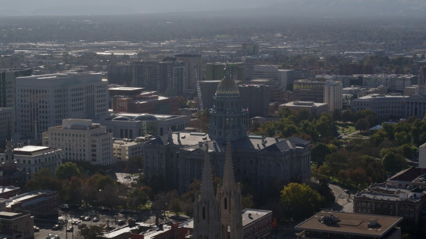 5.7K stock footage aerial video of the Colorado State Capitol seen while ascending by cathedral, Downtown Denver, Colorado Aerial Stock Footage | DX0001_001759