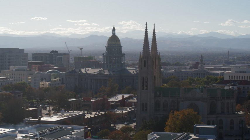 5.7K stock footage aerial video of the Colorado State Capitol and a nearby cathedral, Downtown Denver, Colorado Aerial Stock Footage | DX0001_001762