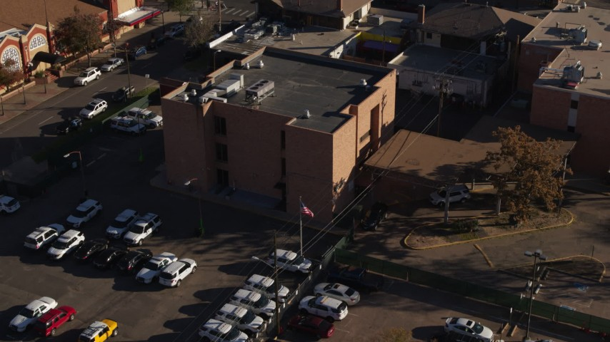 5.7K stock footage aerial video approach and flyby a brick police station in Denver, Colorado Aerial Stock Footage | DX0001_001766