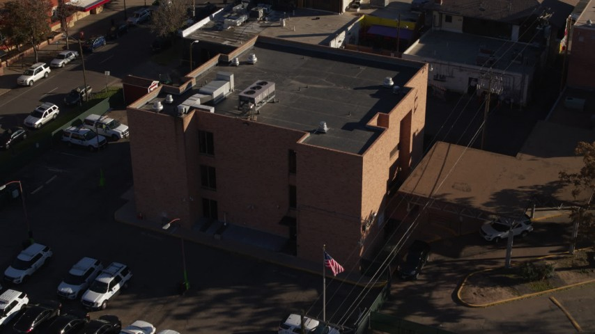 5.7K stock footage aerial video of flying away from a brick police station in Denver, Colorado Aerial Stock Footage | DX0001_001767