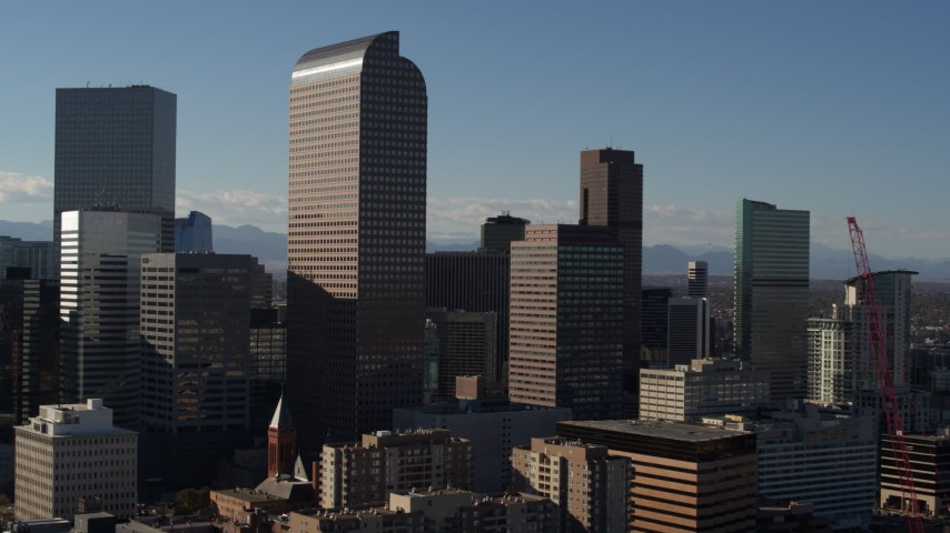 5.7K stock footage aerial video flying by Wells Fargo Center and nearby skyscrapers in Downtown Denver, Colorado Aerial Stock Footage | DX0001_001772