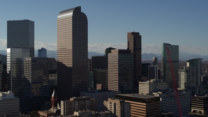 5.7K stock footage aerial video passing by Wells Fargo Center and nearby skyscrapers in Downtown Denver, Colorado Aerial Stock Footage | DX0001_001773