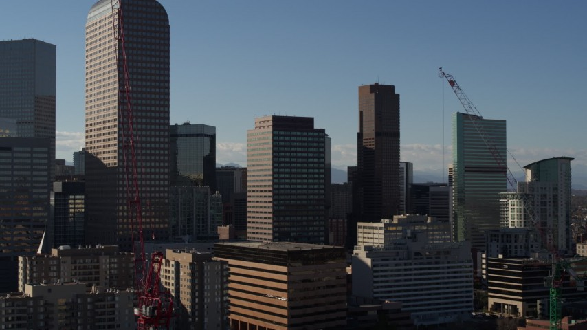 5.7K stock footage aerial video passing by Wells Fargo Center and nearby skyscrapers during descent in Downtown Denver, Colorado Aerial Stock Footage | DX0001_001774