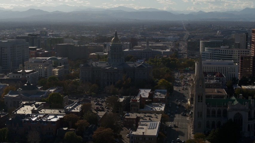 5.7K stock footage aerial video of Colorado State Capitol, Denver City Council and cathedral while descending in Downtown Denver, Colorado Aerial Stock Footage | DX0001_001780