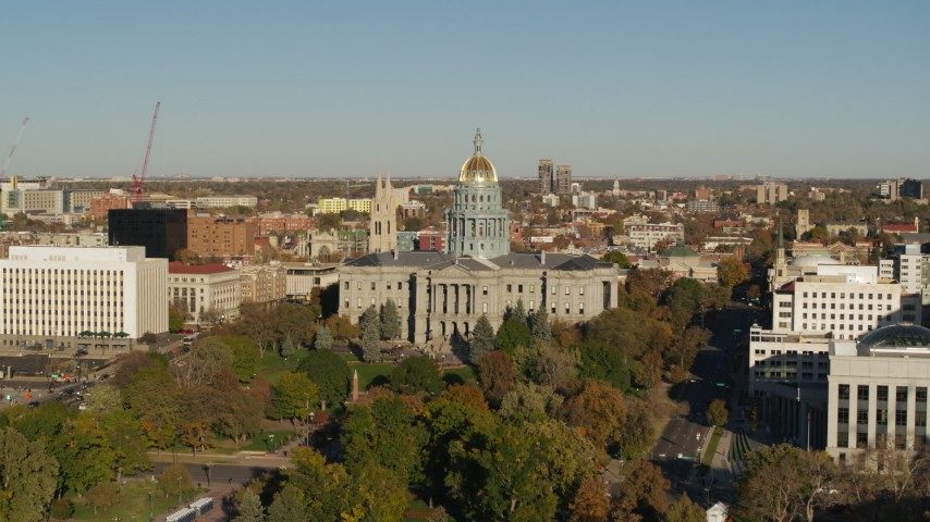 5.7K stock footage aerial video of Colorado State Capitol by tree-lined park in Downtown Denver, Colorado Aerial Stock Footage | DX0001_001782