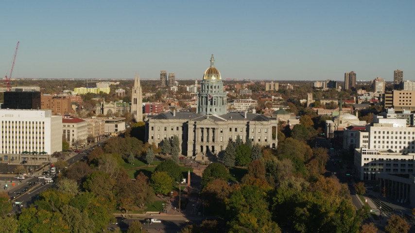 5.7K stock footage aerial video of flying by Colorado State Capitol and tree-lined park in Downtown Denver, Colorado Aerial Stock Footage | DX0001_001783
