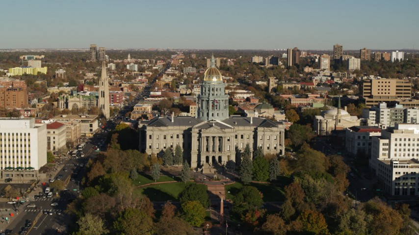 5.7K stock footage aerial video of slowly flying by Colorado State Capitol and tree-lined park in Downtown Denver, Colorado Aerial Stock Footage | DX0001_001784