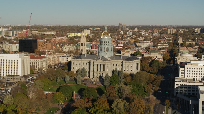5.7K stock footage aerial video of slowly passing by Colorado State Capitol and tree-lined park in Downtown Denver, Colorado Aerial Stock Footage | DX0001_001785