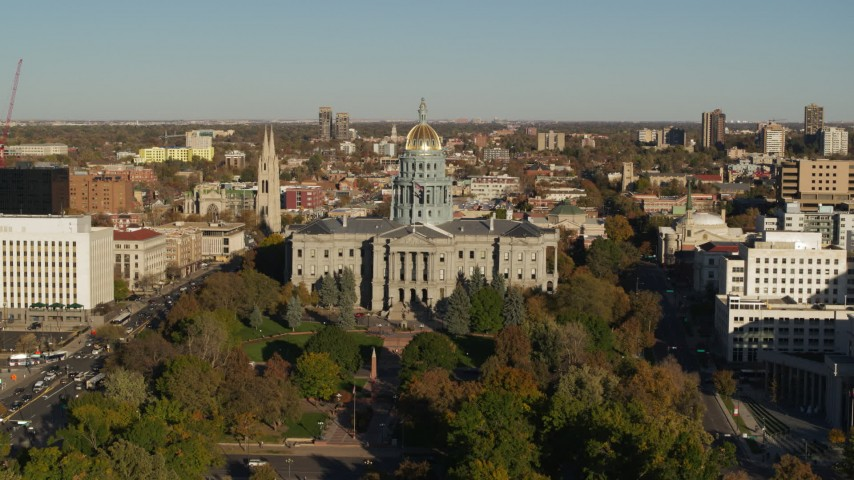 5.7K stock footage aerial video of slow reverse from Colorado State Capitol and tree-lined park in Downtown Denver, Colorado Aerial Stock Footage | DX0001_001786