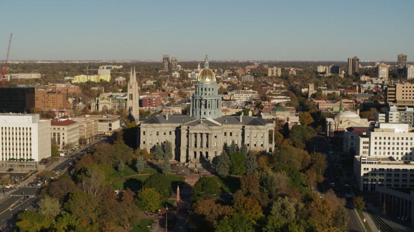 5.7K stock footage aerial video slowly ascend to view the Colorado State Capitol and tree-lined park in Downtown Denver, Colorado Aerial Stock Footage | DX0001_001787