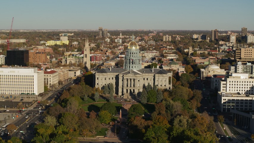 5.7K stock footage aerial video reverse and flyby the Colorado State Capitol and tree-lined park in Downtown Denver, Colorado Aerial Stock Footage | DX0001_001788