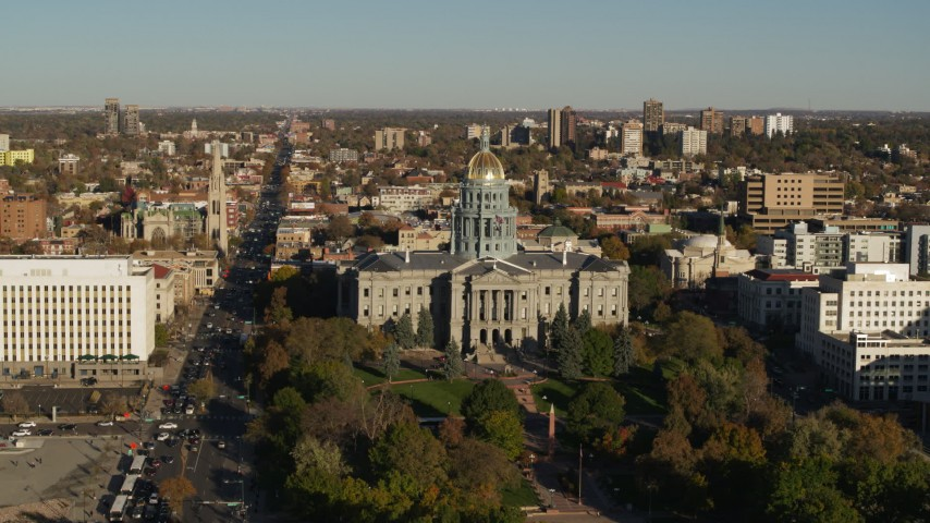 5.7K stock footage aerial video flyby the Colorado State Capitol and tree-lined park, hover for stationary view in Downtown Denver, Colorado Aerial Stock Footage | DX0001_001789