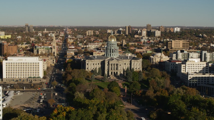 5.7K stock footage aerial video fly away from the Colorado State Capitol and tree-lined park, then descend in Downtown Denver, Colorado Aerial Stock Footage | DX0001_001790