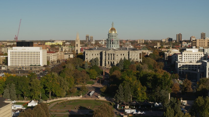 5.7K stock footage aerial video focus on the Colorado State Capitol during short descent in Downtown Denver, Colorado Aerial Stock Footage | DX0001_001792