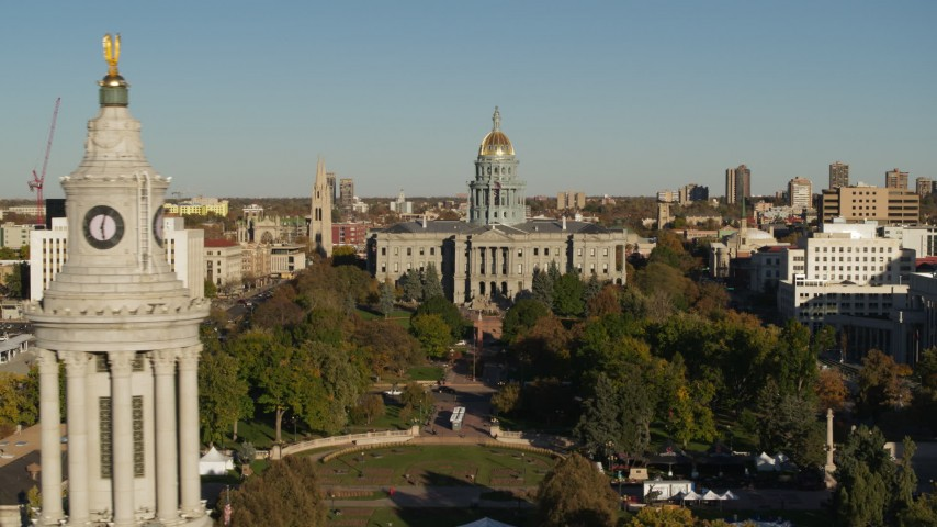 5.7K stock footage aerial video focus on the Colorado State Capitol, reveal clock tower in Downtown Denver, Colorado Aerial Stock Footage | DX0001_001793
