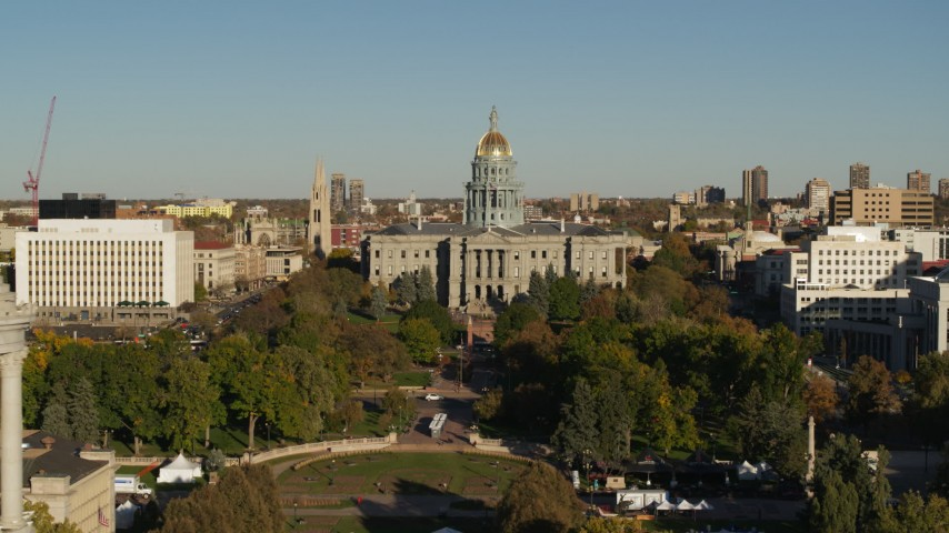 5.7K stock footage aerial video of the Colorado State Capitol, reveal clock tower in Downtown Denver, Colorado Aerial Stock Footage DX0001_001794 | Axiom Images