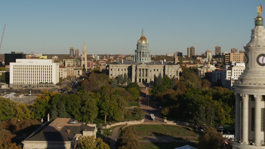 5.7K stock footage aerial video passing the Colorado State Capitol, reveal clock tower in Downtown Denver, Colorado Aerial Stock Footage DX0001_001795