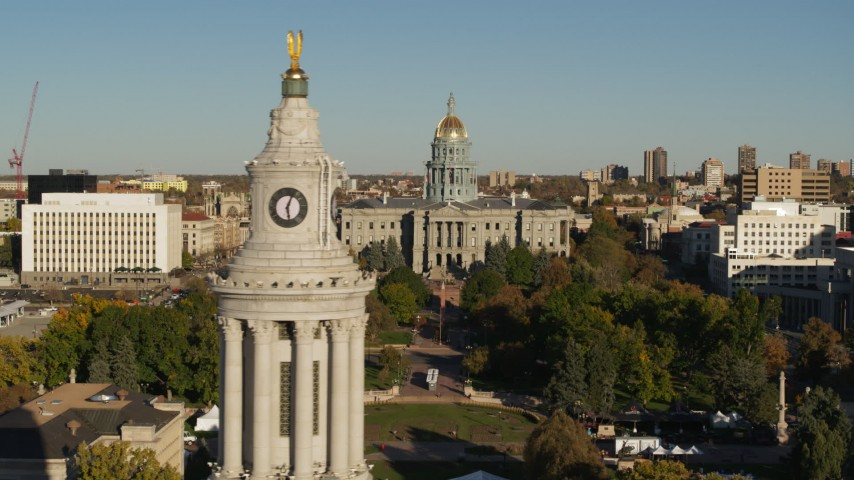 5.7K stock footage aerial video flyby the Colorado State Capitol, reveal clock tower in Downtown Denver, Colorado Aerial Stock Footage | DX0001_001796