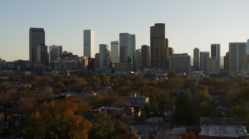 5.7K stock footage aerial video ascend for view of skyline at sunset in Downtown Denver, Colorado Aerial Stock Footage DX0001_001807 | Axiom Images