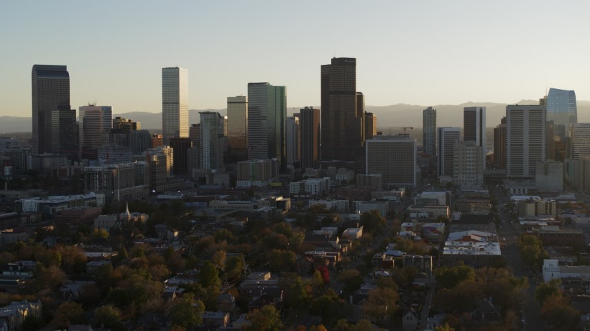 5.7K stock footage aerial video ascending for view of skyline at sunset in Downtown Denver, Colorado Aerial Stock Footage | DX0001_001808