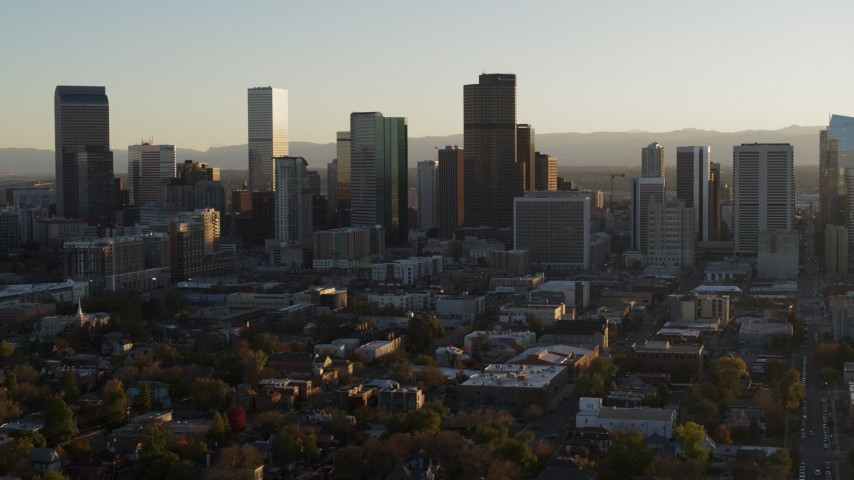 5.7K stock footage aerial video slowly flying by the skyline at sunset in Downtown Denver, Colorado Aerial Stock Footage | DX0001_001809