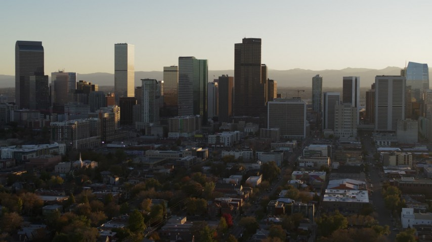 5.7K stock footage aerial video slowly passing by the skyline at sunset in Downtown Denver, Colorado Aerial Stock Footage | DX0001_001810