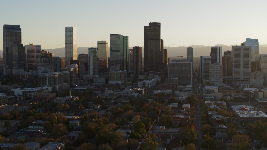 5.7K stock footage aerial video slowly descend and flyby the skyline at sunset, Downtown Denver, Colorado Aerial Stock Footage | DX0001_001811