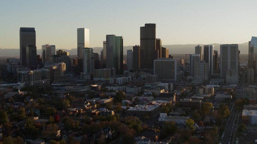 5.7K stock footage aerial video slowly ascend and flyby the skyline at sunset, Downtown Denver, Colorado Aerial Stock Footage | DX0001_001812