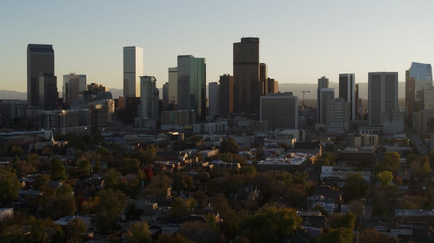 5.7K stock footage aerial video slowly descent while flying by the skyline at sunset, Downtown Denver, Colorado Aerial Stock Footage | DX0001_001813