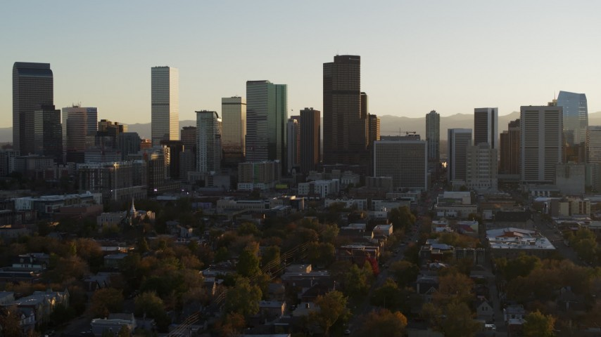 5.7K stock footage aerial video slowly ascend while flying by the skyline at sunset, Downtown Denver, Colorado Aerial Stock Footage | DX0001_001814