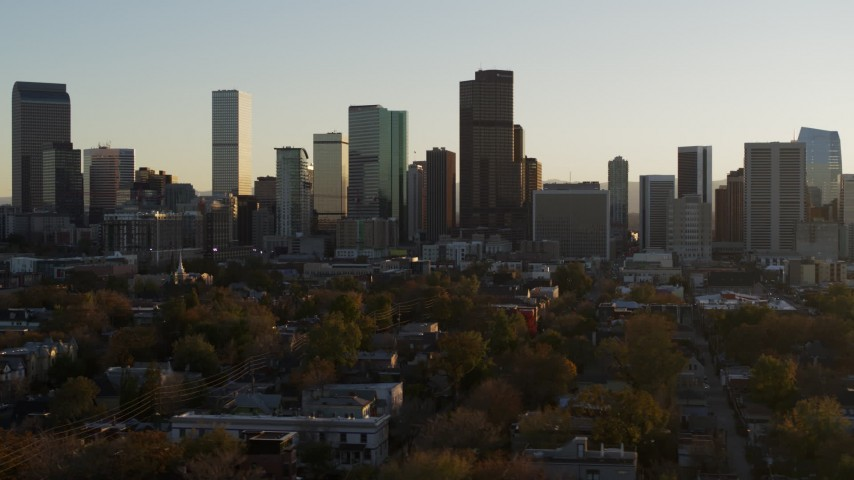 5.7K stock footage aerial video a slow pass by the skyline before ascent at sunset, Downtown Denver, Colorado Aerial Stock Footage | DX0001_001817