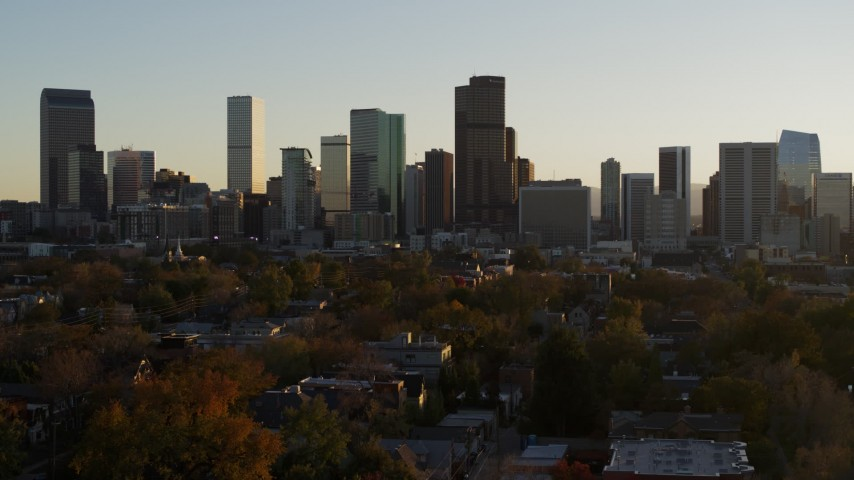5.7K stock footage aerial video of a reverse view of the city skyline at sunset, Downtown Denver, Colorado Aerial Stock Footage | DX0001_001820