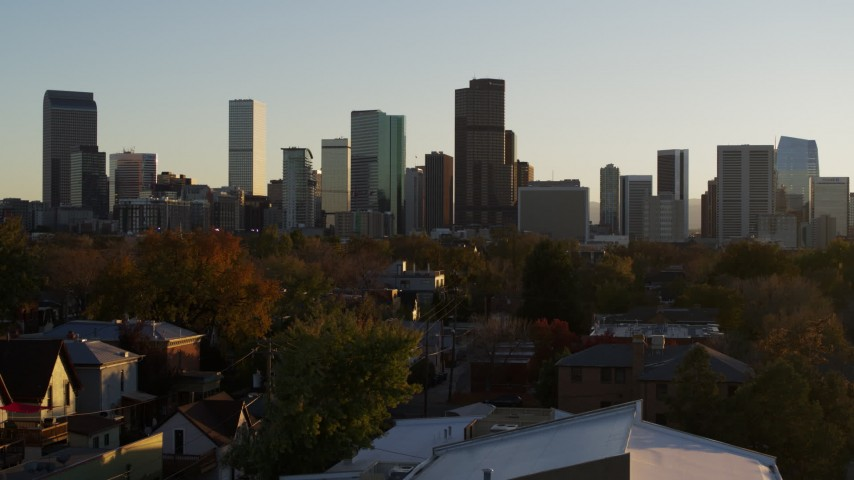 5.7K stock footage aerial video of descending with a view of the city skyline at sunset, Downtown Denver, Colorado Aerial Stock Footage | DX0001_001821