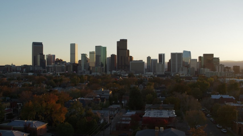 5.7K stock footage aerial video of a stationary view before flying by the city skyline at sunset, Downtown Denver, Colorado Aerial Stock Footage | DX0001_001822