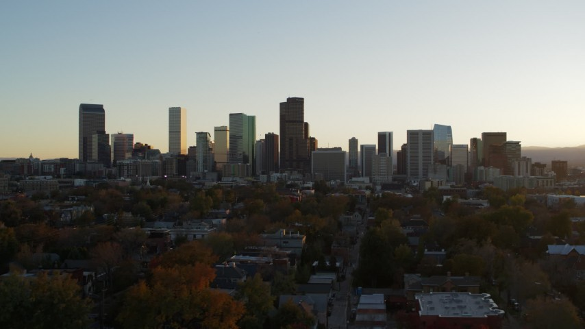 5.7K stock footage aerial video ascend and flyby the city skyline at sunset, Downtown Denver, Colorado Aerial Stock Footage | DX0001_001823