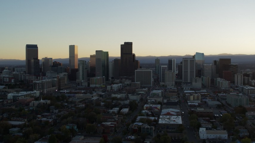 5.7K stock footage aerial video of approaching the city skyline at sunset, Downtown Denver, Colorado Aerial Stock Footage | DX0001_001826