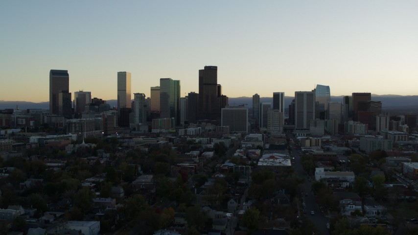 5.7K stock footage aerial video fly away from the city skyline at sunset while descending, Downtown Denver, Colorado Aerial Stock Footage | DX0001_001827