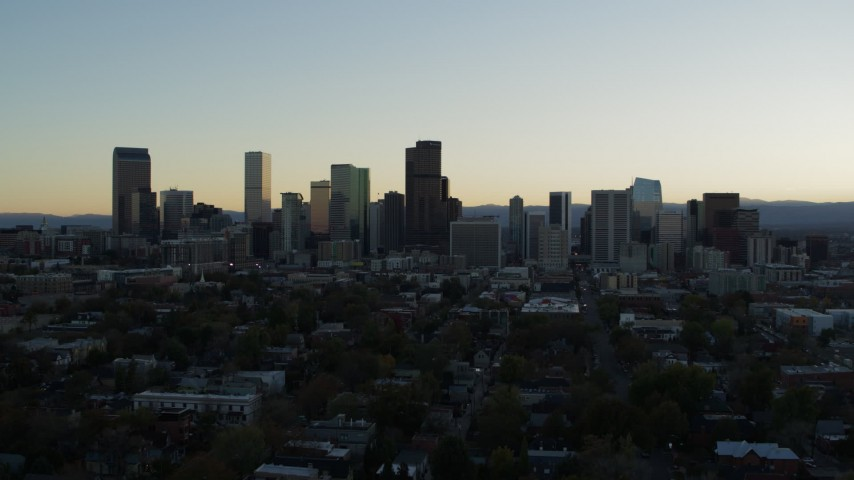 5.7K stock footage aerial video ascend while approaching the city skyline at sunset, Downtown Denver, Colorado Aerial Stock Footage DX0001_001828 | Axiom Images