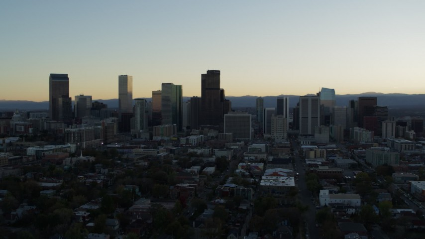 5.7K stock footage aerial video of flying away from the city skyline at sunset, Downtown Denver, Colorado Aerial Stock Footage | DX0001_001829