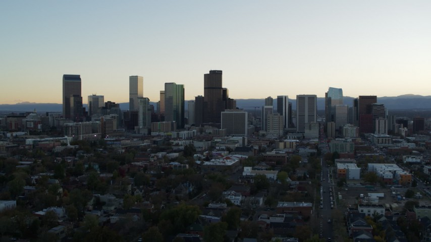5.7K stock footage aerial video of passing by the city skyline at sunset, Downtown Denver, Colorado Aerial Stock Footage | DX0001_001830