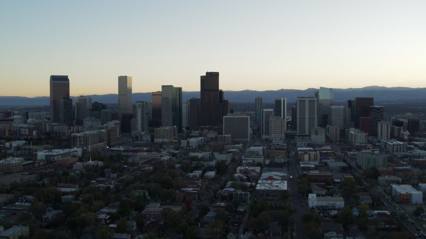 5.7K stock footage aerial video of passing by the city skyline while ascending at sunset, Downtown Denver, Colorado Aerial Stock Footage | DX0001_001831