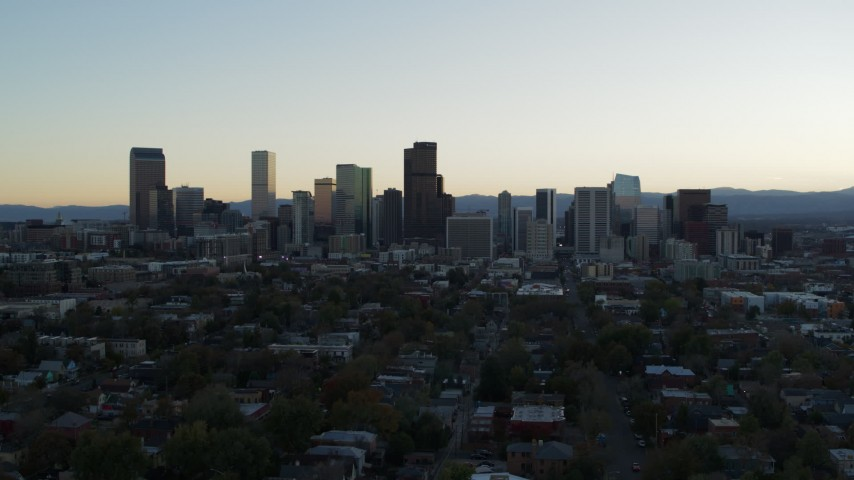 5.7K stock footage aerial video of the city skyline at sunset while flying away and descending, Downtown Denver, Colorado Aerial Stock Footage | DX0001_001834